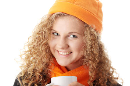 Winter girl with cup of hot tea   photo