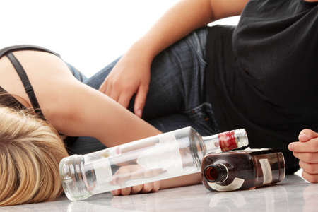 drunken: Teen alcohol addiction (drunk teens with vodka and whisky bottle)