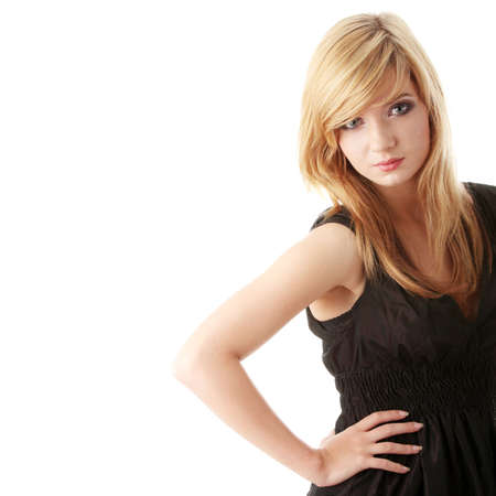 womanliness: Beautiful teenager young girl in black elegant dress