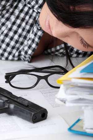 Female kild her self while filling out tax forms while sitting at her desk. Isolated Stock Photo - 5977738