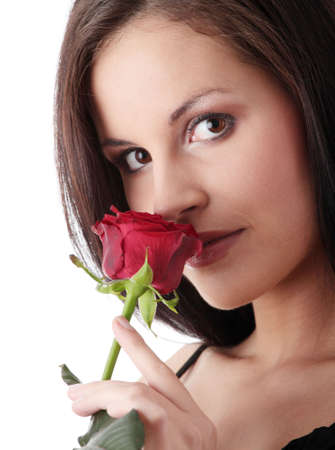 Young caucasian woman in elegant black dress with red rose, isolated on white background photo