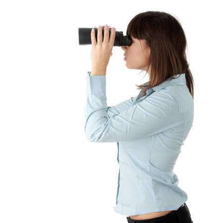 Young caucasian business woman looking throught binocular isolated on white background photo