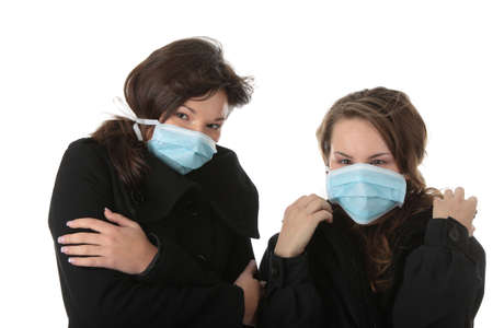 A glamorous model wearing a mask to prevent 'Swine Flu' infection. Isolated Stock Photo - 5955143