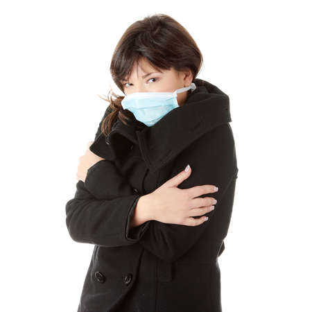 A glamorous model wearing a mask to prevent Swine Flu infection. Isolated  photo