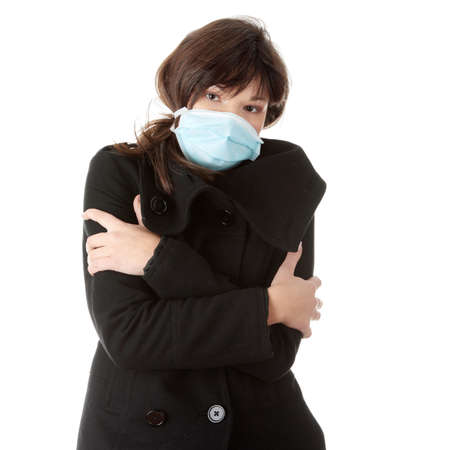 A glamorous model wearing a mask to prevent 'Swine Flu' infection. Isolated  Stock Photo - 5955162