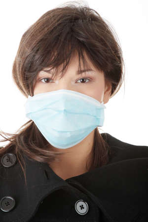 h1n1: A glamorous model wearing a mask to prevent Swine Flu infection. Isolated