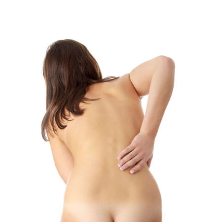 Nude woman from behind. Back pain concept. Isolated  photo