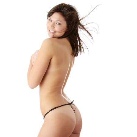 naked young woman: Mod�le de beaut� nue en studio avec des cheveux souffl� par le vent, isol�   Banque d'images