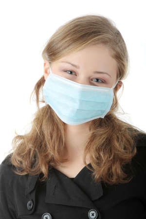 A model wearing a mask to prevent 'Swine Flu' infection. Isolated Stock Photo - 5939421