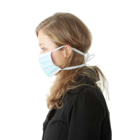 surgical mask: A model wearing a mask to prevent Swine Flu infection. Isolated