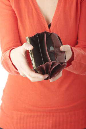 empty wallet: Young woman shows her empty wallet, isolated on white