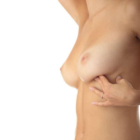Breast cancer - woman examining her breast for lumps or signs of breast cancer  photo