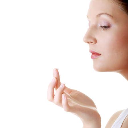 Woman applying moisturizer cream on face. Close-up fresh woman face. Stock Photo - 6039803