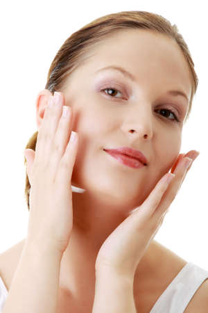 Woman applying moisturizer cream on face. Close-up fresh woman face.  Stock Photo - 6020279