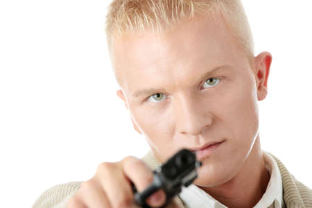 Young caucasian blond man aiming with pistol in hand photo