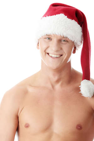 Sexy muscular man wearing a Santa Claus hat isolated on white  photo