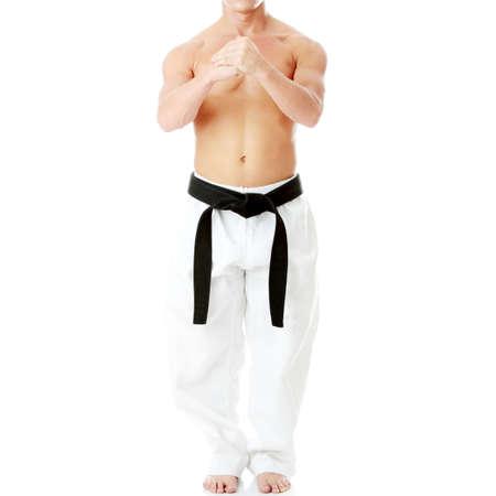 black belt: Taekwondo fighter isolated on white background