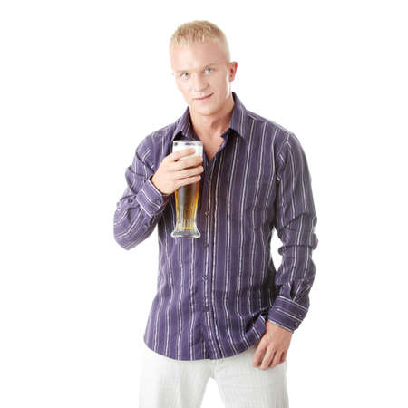 single beer: Happy young man holding a glass of beer isolated