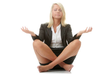 Businesswomen meditating in lotus position isolated on white   photo
