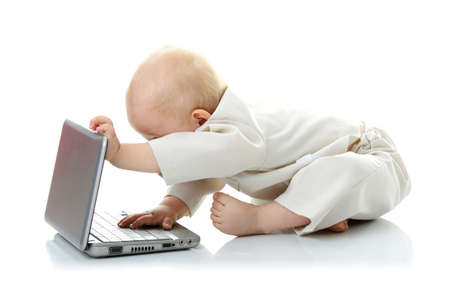 Baby with laptop on the white background Stock Photo - 6019419