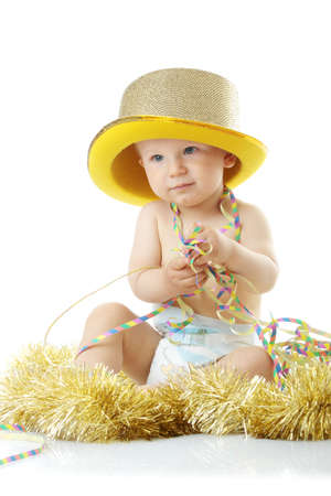 Image of cute baby with new years decoration over white backround photo