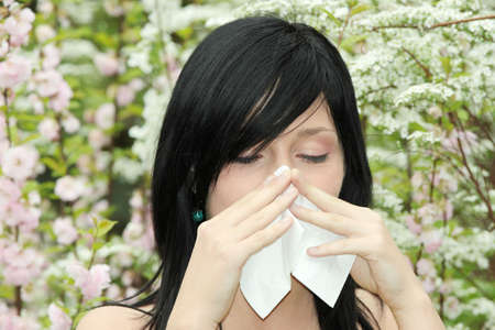 Pretty woman sneeze. Allergy season  photo