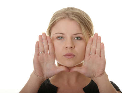Young woman frame her face with palms Stock Photo - 6019500