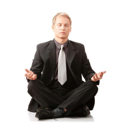 meditation isolated white: Businessman sitting in lotus position isolated