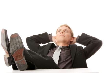 Businessman sitting at desk, isolated photo