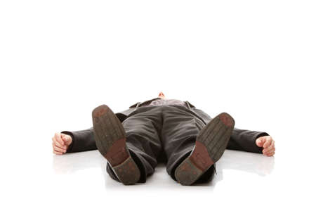 lying down on floor: Businessman laying down in a suit isolated on white background