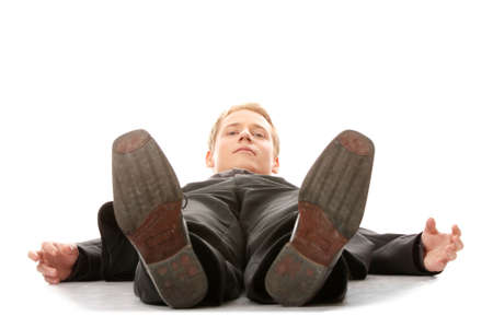 lay down: Businessman laying down in a suit isolated on white background