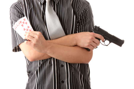 Young poker player with gun isolated on white photo
