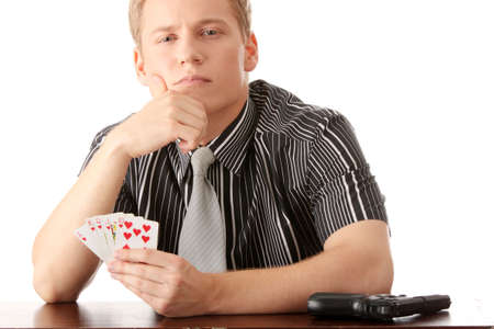 Young poker player with gun isolated on white Stock Photo - 6020237