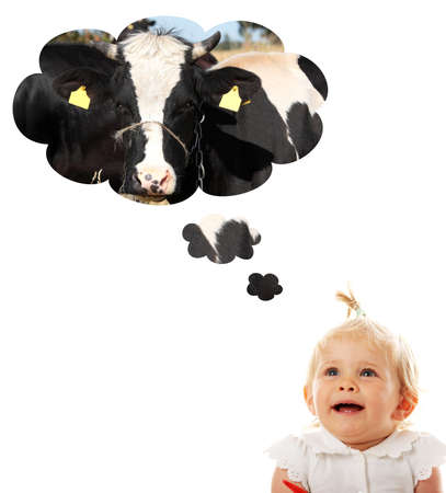 Blond caucasian baby girl thinking about cow (milk)  photo