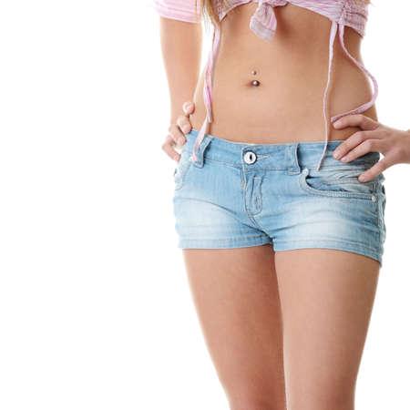 waist: Cerca de cintura de una hermosa mujer aislada en un fondo blanco  Foto de archivo