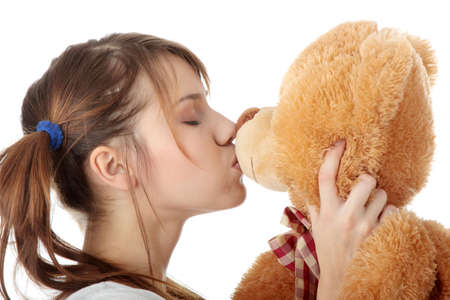 nude little girls: Young beautiful teen woman in long shirt with her teddy bear, isolated on white background