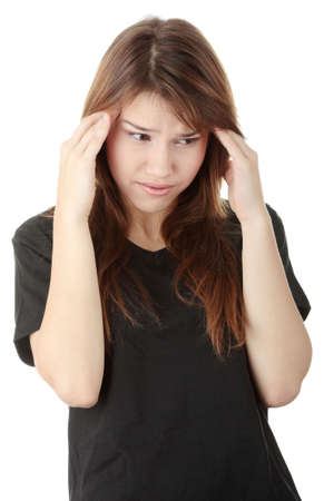 Young woman having a headache ,isolated on white background photo