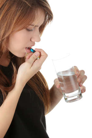 Young caucasian woman with glass of water taking pills,isolated on white background Stock Photo - 6039850