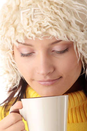 Teen winter girl with cup of hot drink (tea,coffee or milk) Stock Photo - 6039952