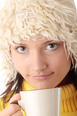 Teen winter girl with cup of hot drink (tea,coffee or milk) photo