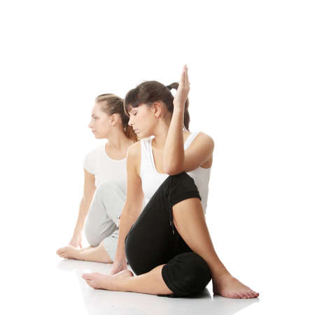 Two womans exercising, isolated on white background
