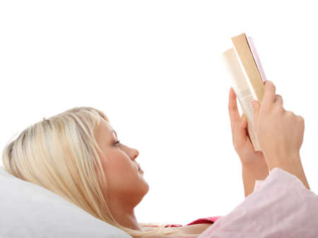 Portrait of beautiful sexy happy blond caucasian woman reading book at bed photo