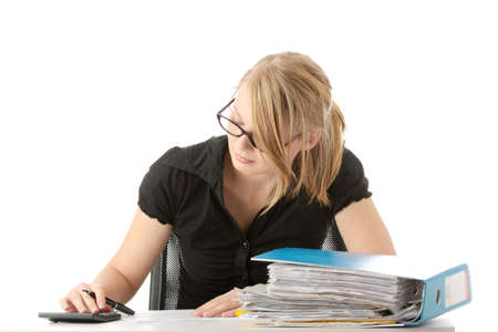filling out: Female executive filling out tax forms while sitting at her desk. Isolated Stock Photo