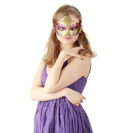 Young beautiful woman in violet dress wearing carnival mask, isolated photo