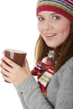 Young woman in winter hat with cup of hot chocolate or coffee or tea  photo