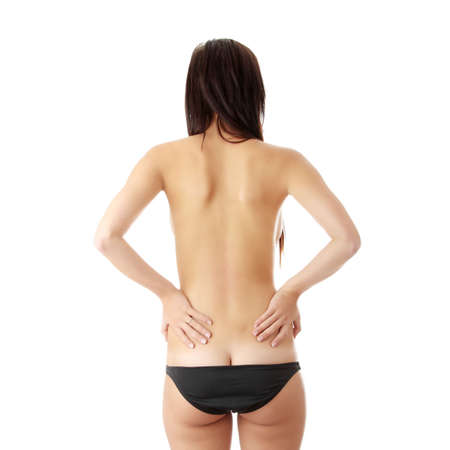Nude woman from behind. Back pain concept. Isolated Stock Photo - 6177632