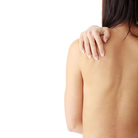 woman nude standing: Nude woman from behind. Back pain concept. Isolated Stock Photo