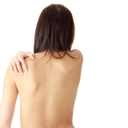 Nude woman from behind. Back pain concept. Isolated Stock Photo - 6177693