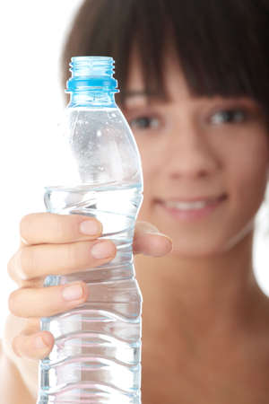 Woman drinking water isolated over a white background Stock Photo - 6173071