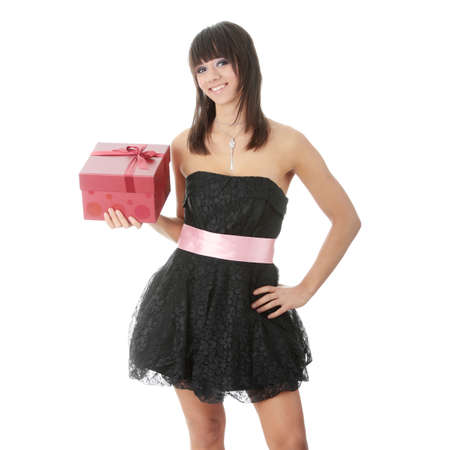 Young elegant woman in black dress with gift box, isolated on white  photo